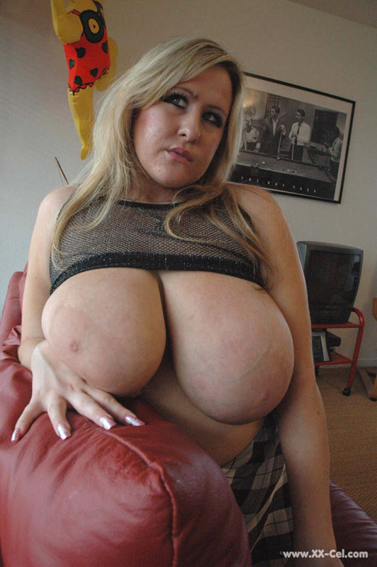 Lusty blonde plumper undressing and playing with her big - Picture 4