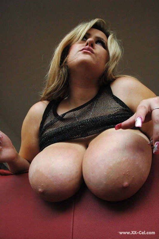 Lusty blonde plumper undressing and playing with her big - Picture 10