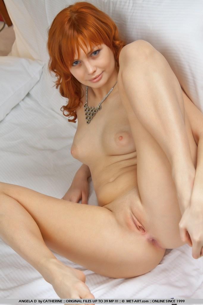 Nude redhead woman bush