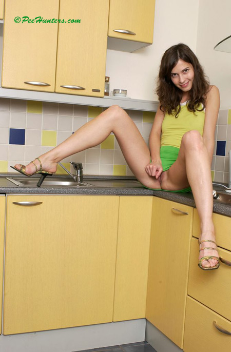 Cute Teen Peeing On The Kitchen Xxxonxxx Pic