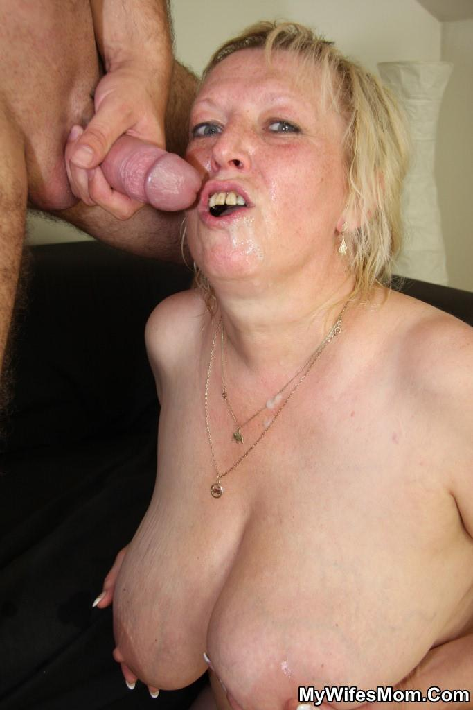 image Plump mature woman swallows two cocks at once