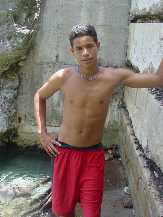 A robust young bronze latino sunbathing among the rocks and wanking that impossibly large dick of his until he cums - XXXonXXX - Pic 1