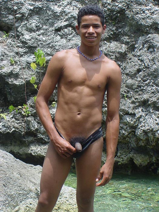 A robust young bronze latino sunbathing among the rocks and wanking that impossibly large dick of his until he cums - XXXonXXX - Pic 4