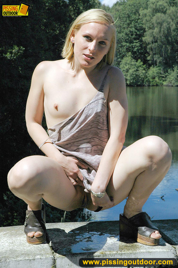 Shes pissing outdoors