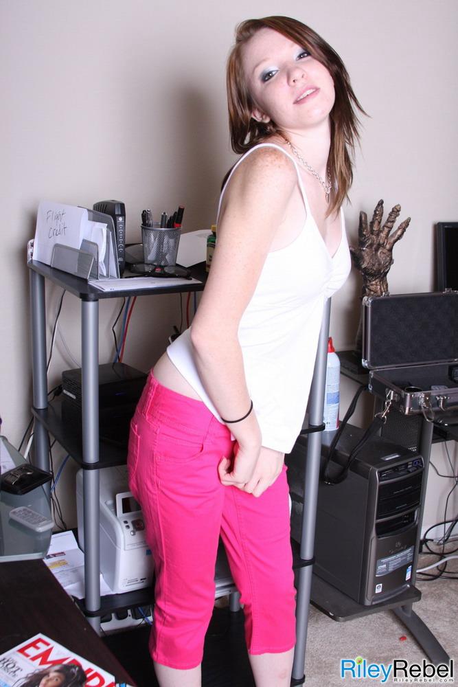 Sexy redhead Riley Shy masturbates with the help of a sex toy  310661