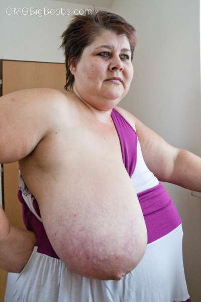 Old fat slut with gigantomastia gets naked - Picture 8