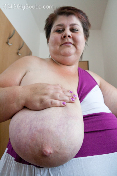 Old fat slut with gigantomastia gets naked - Picture 10