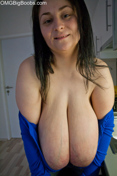 Brunette mature wearing a deep cleavage exposing her - Picture 13