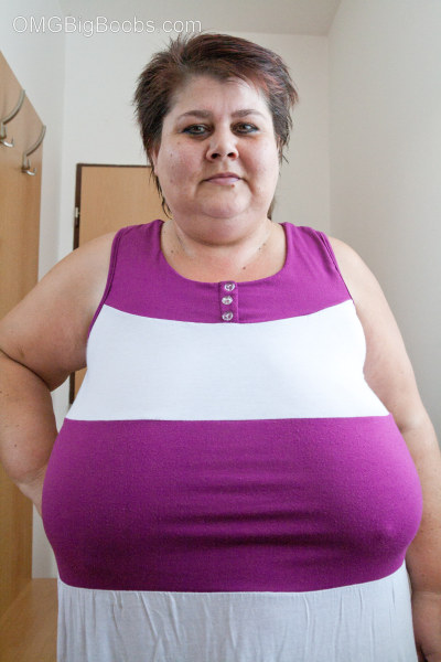 BBW in a striped dress demonstrating her milk farm - Picture 2