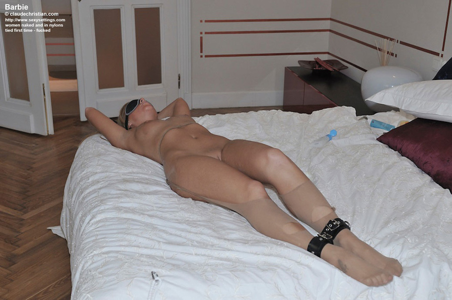 What tied spread on bed and shaved