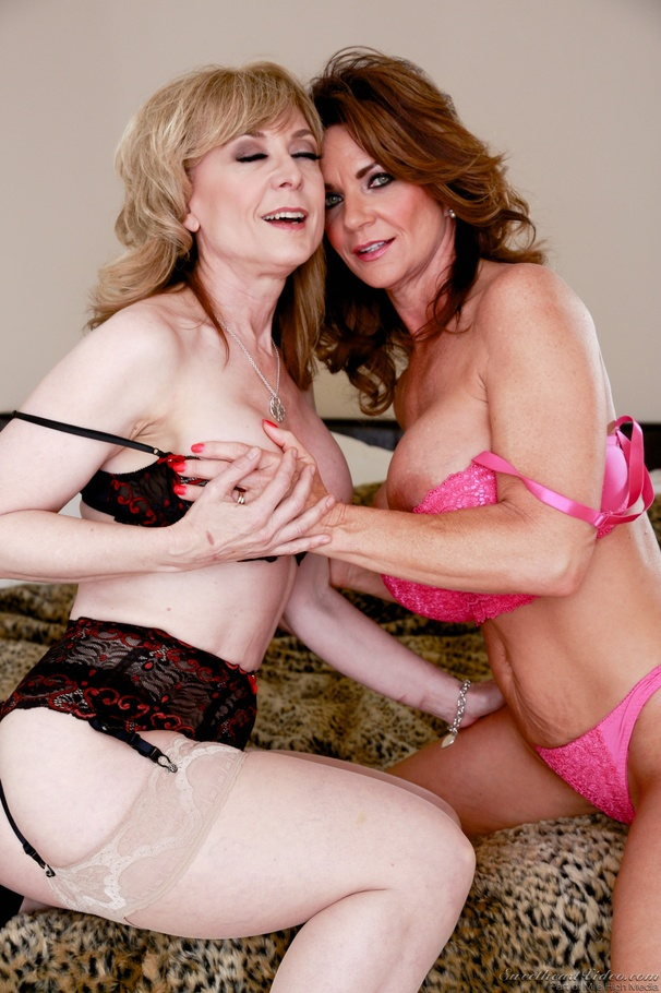 Overdressed Blonde Gilf Posing With A Busty Blue-Eyed Milf ...