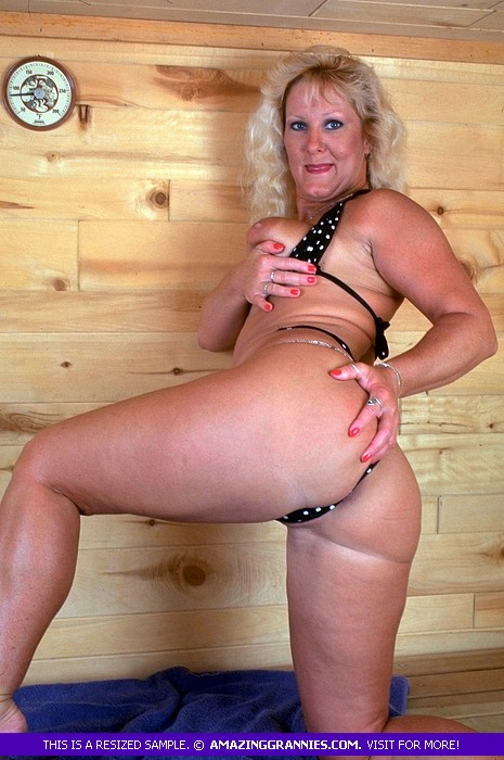 Lusty granny with fat body shows her big breasts and nasty pussy in  different poses wearing