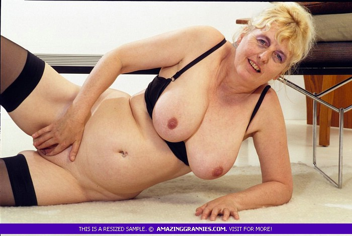 Indulging granny shows her big tits and nasty pussy as she lays on the  floor and displays her fat body in different poses wearing her black bra,  ...