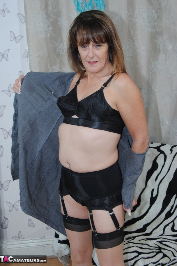 A Brunette, Gilf, With A Belly Button Piercing Rubs Her ...