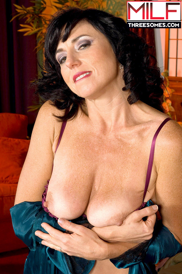 Dark hair milf in sexy lingerie sucks and screws two guys and they eat her  pussy