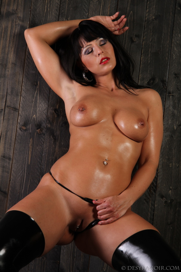 Oiled-up brunette in latex stockings teasing her oily pussy - XXXonXXX -  Pic 2