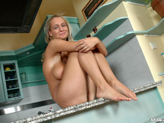 Lusty blonde mom with huge breasts playing with her - Picture 10