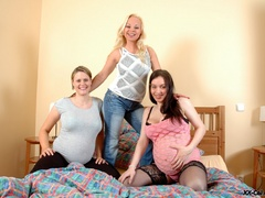 Three busty pregnant chicks don't mind being watched - Picture 1
