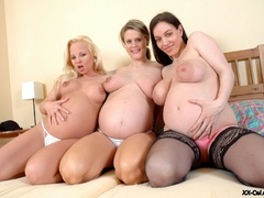 Three busty pregnant chicks don't mind being watched - Picture 7