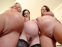 Three busty pregnant chicks don't mind being watched - Picture 11