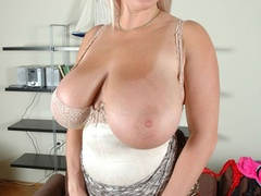Adorable blonde milf undressing and exposing her - Picture 6