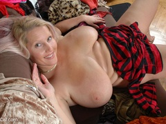 Adorable blonde milf undressing and exposing her - Picture 10