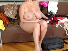 Adorable blonde milf undressing and exposing her - Picture 12
