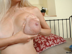 Super hot blonde chick revealing her big tits out of bra - Picture 12