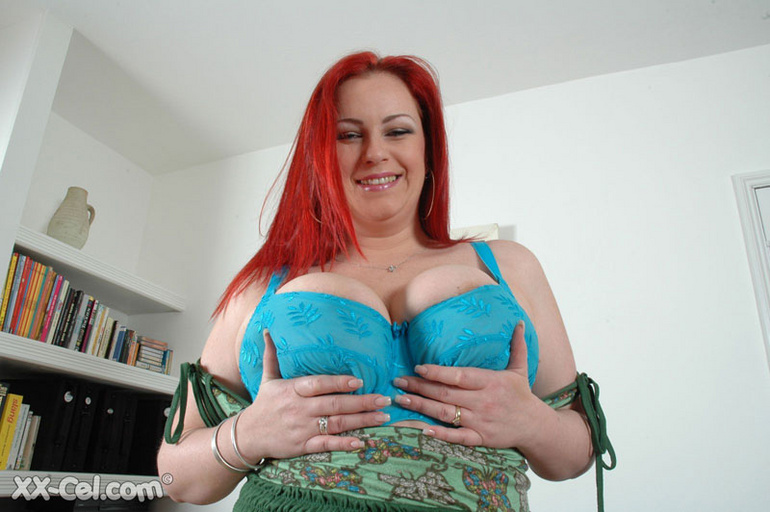 BBW redhead stunner with heavy melons stripteasing on a - Picture 2