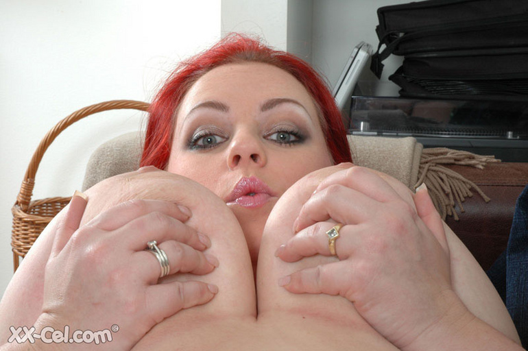 BBW redhead stunner with heavy melons stripteasing on a - Picture 6