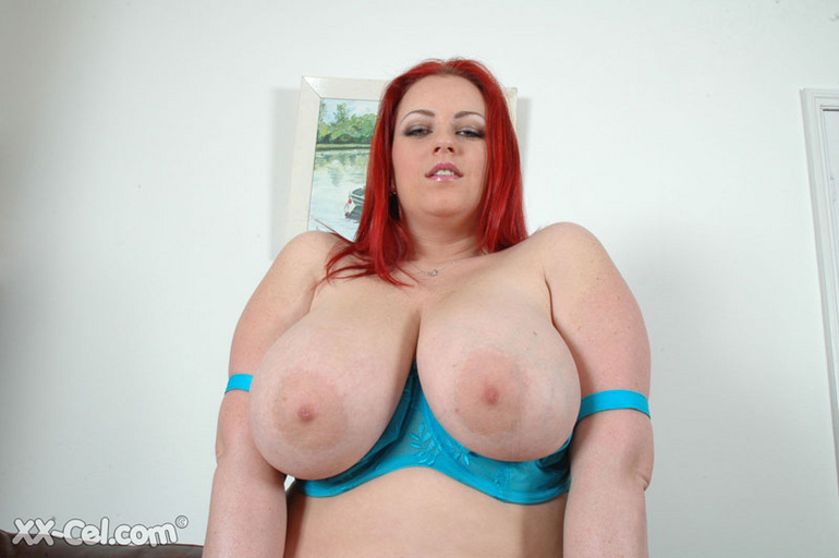 BBW redhead stunner with heavy melons stripteasing on a - Picture 8