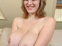 Big boobied smily chick slowly taking off her clothes - Picture 8