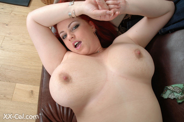 BBW redhead stunner with heavy melons stripteasing on a - Picture 12