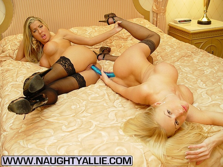 sensual blonde with nice ass is playing with toys