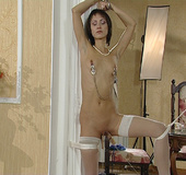 Sexy slave in sexy stockings gets her boobs and pussy humiliated.