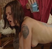 Submissive slave brunette suffers a hot wax on her…