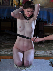 Totally nude enslaved brunette forced to give a hed to - Picture 8
