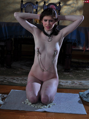 Totally nude enslaved brunette forced to give a hed to - Picture 10