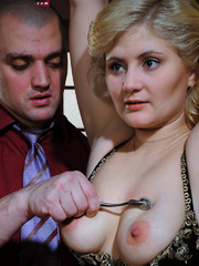 Lusty blonde slave gets her pussy whipped while riding - Picture 1