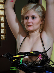 Lusty blonde slave gets her pussy whipped while riding - Picture 3