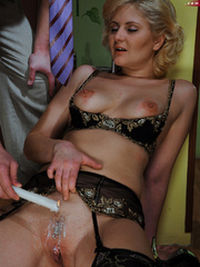 Lusty blonde slave gets her pussy whipped while riding - Picture 7