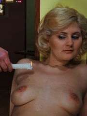 Lusty blonde slave gets her pussy whipped while riding - Picture 8