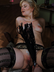 Lusty blonde slave gets her pussy whipped while riding - Picture 13
