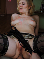 Lusty blonde slave gets her pussy whipped while riding - Picture 14