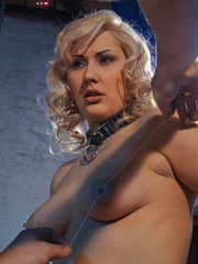 Blonde flexible slave with yummy boobs gets her nipples - Picture 2
