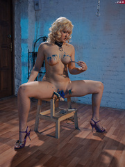 Blonde flexible slave with yummy boobs gets her nipples - Picture 12