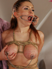 Bound brunette slave with epic boobs gets her pussy lips - Picture 9