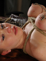 Bound brunette slave with epic boobs gets her pussy lips - Picture 11