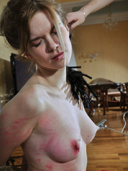 Helplessly bound slave hottie gets her body worked over - Picture 8