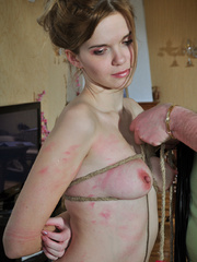 Helplessly bound slave hottie gets her body worked over - Picture 10